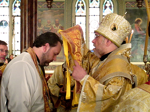 Father Nikolay receives the nabbedrennik from Bishop Michael.