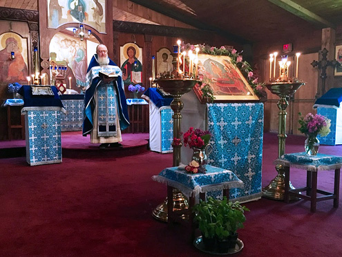 Fr. John preaching on the feast of the Dormition